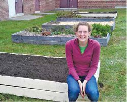 LHS senior and SSF member Nell Houde with the raised garden beds she helped build last year.