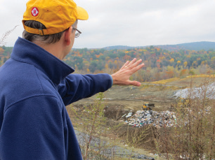 The author's father takes in the view of the landfill, where a proposed electric generator would turn harmful methane gas into energy.