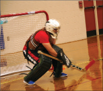 Ben Arellano works out as the goalie for the Red Team.