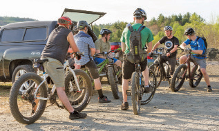 Jason Ouelette from Mason Racing at the Nature Walk trailhead with some of the mountain bikers participating in the Thursday night group ride in the Boston Lot