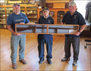 Displaying the musket donated by Bill Lapan (left), are Richard Courtermanche and Bob Therrien.