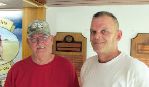 Larry Greenwood and Eric Morrill in front of part of the mural
