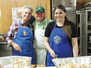 Len Angelli with volunteers Frank Gesek and Maria Gesek