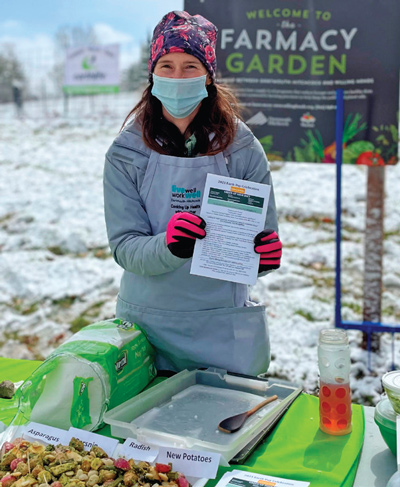 Heather Wolfe educates those interested in learning more at the unusually cold spring day's event.